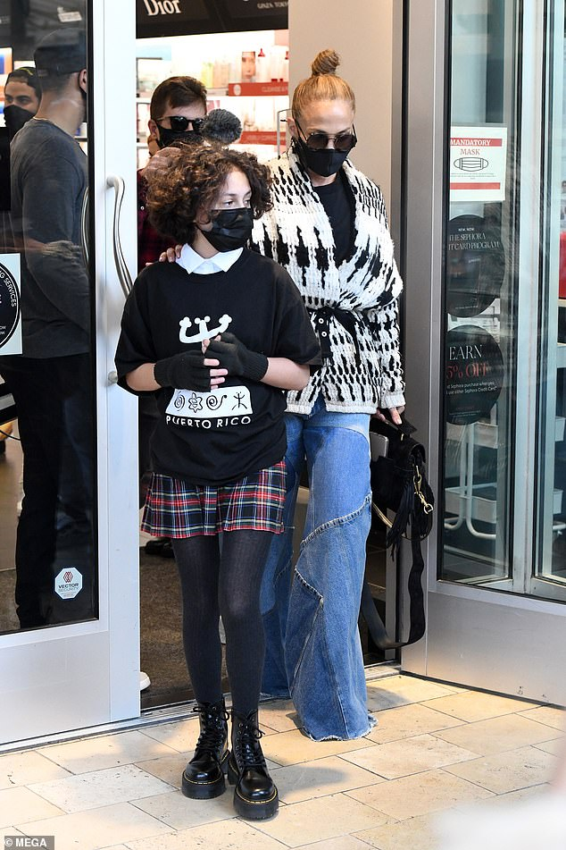 Proud: Lopez also joins her daughter Amy, 12, to check out the retail offer