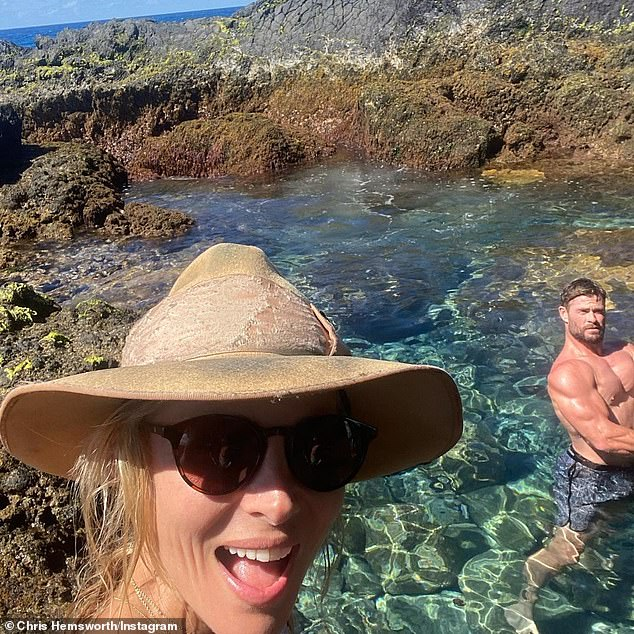 Bring the heat!  Chris (right) sent fans in a frenzy when he flaunted his muscular arm while he was on a beach date with his wife, Elsa Pataky, 44 (left)