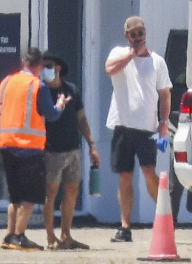 Action: Chris Hemsworth, 37, (pictured) covered his iconic physique in a white shirt and shorts as he flocked to Sydney to start filming Thor: Love and Thunder on Wednesday